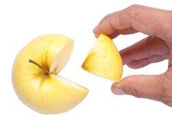 A Hand grabbing an Apple